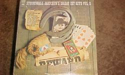 THIS ALBUM STONEWALL JACKSONS GREATEST HITS WAS RELEASED IN 1969 ON THE COLUMBIA RECORD LABEL. ITS NUMBER IS CS-9770. SOME OF THE FEATURED SONGS ARE IF HEARTACHES WERE WINE, OLD SHOWBOAT AND MARY DON'T YOU WEEP. THE CONDITION OF THE ALBUM AND SLEAVE ARE