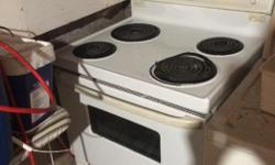 Working oven and stove top missing one dial for one of the stove top elements. Also needs trays for the stove top