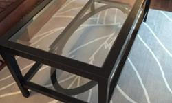 """Structube rectangle coffee table for sale. 48"""" long, 24"""" wide, and 19.5"""" high. Two levels, glass top, black wood frame. Originally paid over $300. Asking $150."""