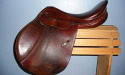 """Lovely close contact saddle in very good used condition. Soft, well cared for, some cosmetic wear at leg contact points of skirt. 17"""" seat, 31cm tree. Mahogany in colour (reddish chestnut).  Comes with leathers, stirrups and girth.  Made in Switzerland."""