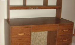 """Student's Desk with removable Bookcase Hutch; Desk measures 47.5"""" wide X 24"""" deep X 29"""" high (or 56.5"""" high with Bookcase Hutch attached). Also offering Swivel Chair. Price $25 each or both for $40. Call 250-756-2789 and ask for Judy."""