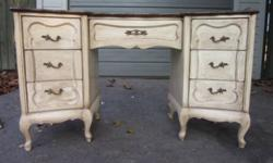 Beautifully made vintage 1940s French Country Queen Ann double pedestal desk with a lovely curved design custom refinished by a local artisan.  Top has been stripped and stained and sealed, contrasted with a soft antique white treated with a rubbed finish