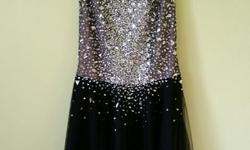 This beautiful Prom Dress was bought in the designer district of St-Hubert street in Montreal. It is a $600. dress. It is in excellent condition, wore once. Price is firm. Size is XS 2/4.