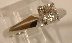 BEAUTIFUL DIAMOND ENGAGEMENT RING...SURPRISE HER FOR NEW YEARS EVE....THE QUALITY OF THIS ENGAGEMENT RING.IS BREATHTAKING...CLARITY..VS2.....COLOUR..I-J EST.WEIGHT...0.36 carat...18K WHITE GOLD....THIS RING WILL SELL QUICKLY...MAKE NO MISTAKE ABOUT IT!!!