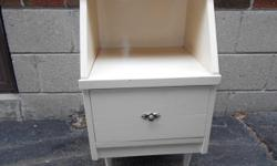 Great condition, solid and sturdy. Heavy solid wood, not veneer, vintage night stand with mid century modern tapered legs. Shabby chic ivory colour with lovely vintage pull and brass caps on the front legs. Drawer slides well. Very good condition. May be
