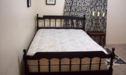 I have a Spring Air double/full bed set in great condition for sale. Very comfortable. Its a soft mattress. Comes with a black colonial frame with headboard/footboard and rails. The mattress and boxspring rest on a metal bed frame inside the frame. Clean,