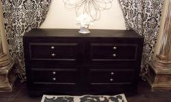 "Selling a stylish black 8 drawer dresser chest. It is vintage but in great condition. Made of 100% solid wood. The drawers have beautiful detail and have silver knob. All the drawers are clean and slide well. Measures 58 "" long x 19"" deep x 33""high."