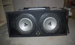 """For Sale! Two, 10"""" JL Audio Subs with a PG Octane R 5.0.1 amp and a sub box for it all. The box is 30.5""""*13""""*13"""" and will fit in any trunk. I'm asking the incredibly low price of $200 for everything included.  All you need is the wiring. If you have any"""