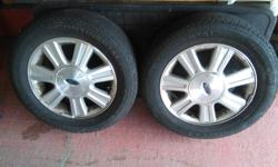 4 rimmed summer tires, less than 500km, 2 years old hardly driven on. Tire # P215/60R16 94T. Good for 2003 Ford Taurus Good condition.