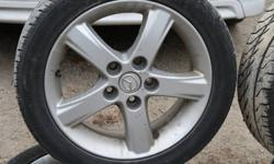 """4 x 16"""" summer tires on aluminum rims from an 03 Mazda - Kumos 195-50-16 $100.  Please call 705 352-0836 if interested."""
