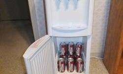 Moving. Must sell a Sunbeam water cooler in excellent condition. Hot, cold & room temperature spigots. Cold fridge at bottom, excellent for drinks. Everything works very well. Original manual included. Phone 705-730-5598, (Barrie)