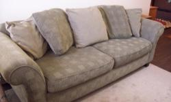I have a very comfortable large green bauhaus sofa for sale. In great condition and the fabric is soft tweed and has a checkered pattern. Clean, no rips, no stains, no bugs. The seat and back cushions have just been washed for you! It is 71/2 feet long so