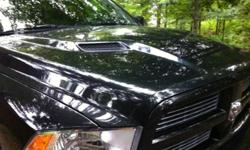 Super sport hood off 2011 dodge 1500. Very minor factory damage, hardly noticeable. Black in colour This ad was posted with the Kijiji Classifieds app.