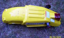 I have a nice bright yellow rear fender that came off a 1992 suzuki RMX 250 enduro bike, part number 63113-05D00-25Y . New it would cost you approx. $100. It is in excellent condition other than the sides are cracked, I can plastic weld that. I also have