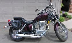1986 Suzuki Savage 650. 21,946 original kms. Is in very nice condition, is my wife's bike. Has leather saddlebags and tool pouch, windshield, Harley drag bars with risers, custom paint and powder coating, near new tires, new battery. A great cruiser, low