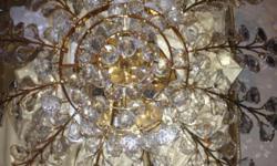 Swarovski chandelier. Never been used. Cash only.