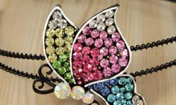 Colourful butterfly with sparkly crystals! new Swarovski crystals used. Not trademark.