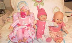 My name's Kimberly and I'm selling three cute little cushy baby dolls and carrier. One doll has a magnetic soother that you can remove and the other doll is mechanical and kicks her legs and moves her head and giggles gleefully! All three are in good