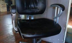 I have two black padded swivel desk chairs. $25 each.
