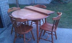 table and 4 chairs with 2 leafs