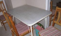 I have an older metal framed very sturdy table with a brand new set of 4 chairs, the chair cushins are home made and are included as well. Table comes with a removable table leaf.   Please contact me by e-mail or my uncle Ed by phone at the number