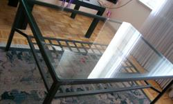 Table Coffee Table Iron Glass - $155 (Yonge & College) Table Coffee Table Iron Glass - $155 OR Best Offer (Yonge & College) Glass and Metal Coffee Table with lower magazine shelve 31 Inches Wide 46 Inches Length 19 Inches Height Excellent condition non
