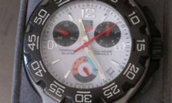 I am selling one of my Tag Heuer Formula 1 Chronograph watches. Excellent shape! New price was over $1300. Comes with box and extra link. This is NOT A FAKE!!  Here are the specs on it. Brand Name: Tag Heuer Model number: CAC1111