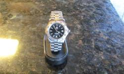 Hi, I am selling my Tag Heuer WK1110-1 professional 200 meter watch.  This watch is in excellent condition.  Please call Albert @ 403-255-3335 for more info if you are seriously interested.