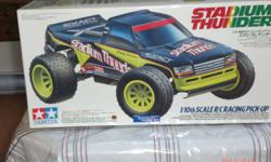 RC Stadium Thunder - Ltd Production Item #58181 this is a new old stock that I only took the plastic rap off to show the contents inside. the little parts bags have not been opened or the parts removed from the molding frames. I also have other tamiya