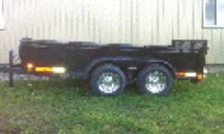 5 x10 Tandem axle , chrome wheels , new spare tire , rubber coating on front of trailer to prevent stone chips. Trailer is in new condition . Selling because I need a larger trailer . Please call Brad at 519-809-5865 This ad was posted with the Kijiji
