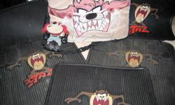 """Have changed cars and now need to sell my original car accessories. For Sale: 1. Four (4) gently used rubber car floor mats - 2 front and 2 back mats with our favourite, lovable character """"Taz"""" the Tasmanian Devil. 2. A lumbar support """"Taz"""" backrest"""