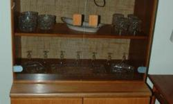 Teak Buffet & hutch with smoked glass doors. Perfect condition. Paid $799.00 + tax at Mostly Danish. $175.00 firm