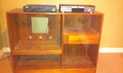 Teak entertainment center in excellent condition. 17 deep x 45 long by 35 high. Drawer has brackets for dvds.