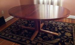 """This teak dinning room table is 64"""" by 45"""" with a 20"""" leaf. The condition is excellent."""