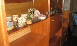 Make an offer on this beautiful teak wall unit, excellent condition, very solid, purchased new in 1979 for over $2000. One owner. Very well made. Glass doors on top with lights in each section, spacious cupboards on the bottom for lots of additional