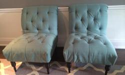 Pair of teal tufted occasional chairs. Espresso wooden legs.