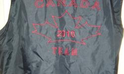 Team Canada 2010 navy nylon vest with hidden hood (in the collar). Has large logo on back, brand new, never worn (has tag thingy but no tag). Size unisex Medium Now only $10 P/U north end Barrie, near RVH   Check out my other ads for great deals!  Make me