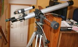 This telescope is about 30 years old but has been kept in good condition. It is a 60 x 910 mm scope with multiple lenses, projection ability, and many other do-dads. It comes in a custom wooden box, the original one it was purchased with.