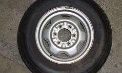 Temporary Spare for 6 hole Pathfinder and 4 Runner. Excellent cond. 215 x 75 R15.