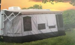 CAREFREE VACATION'R WRAP-AROUND TENT. Fits tradional and 12 Volt awnings with vertical arms. Quick and easy setup. Versatile door can be installed on left or right side. Comes in a convenient, lightweight storage bag, stakes and skirting. Cost new from