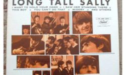 The Beatles Long Tall Sally Canadian LP. 1976 reissue, orange Capitol label. Serial # T6063. LP has light surface scratches, a bit more on side 1, but very clear playing. Cover in great shape with only a light bit of wear on front cover. Pick up or mail