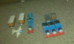 Thomas and Friends Trains and alot of tracks also comes with an airport and some trees and other accompaniments. There are 4 Thomas trains(batt operated) and Gordon, Clarabelle and a few more....ALL for just $20.00