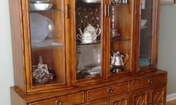 "We are unable to take this furniture to our new home. Thomasville Brighton Pavilion made of pecan in North Carolina. Display cabinet- 64"" w, 18"" d, 84""h - base and upper cabinet can be separated (base is 25""h, cabinet is 59""h) Upper cabinet has 4 glass"