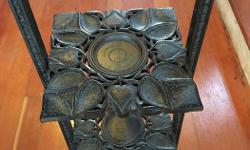 Carved mahogany 3-tier table, perfect for curious, plants or ? Folds flat for storage.