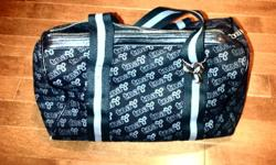 Hello I'am selling my moms used TNA handbag. The colour is Black and the pattern is Grey, as seen in the pictures. The bag was purchased less then a year ago for $55 at Aritzia. I'am selling it for $40 less because the bag has been well used, with a few