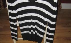 Never worn, Black and white striped Tommy Hilfiger V-neck sweater. $30.00
