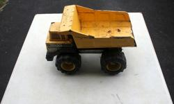 For sale is a Tonka metal dump truck. A little rusty as shown in the picture.