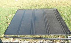 """Original Ford Tonneau Cover 80"""" long 62.5 Wide. Does not fit my  2010 F150  6'5"""" box. The cover is Ford accesssory Backflip model. I bought it to fit my F150 and since it doesn't fit reselling it. It came off of a F350  2011 Lariat. Excellent condition,"""