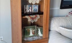 """Two doors, upper one glass, bottom one wood - looks like drawer fronts. One glass shelf (removable), one wood shelf (adjustable) behind glass door. Interior light. CD/DVD tray behind bottom door pulls out. Oak. 65 ½"""" high, 20 ½"""" wide, 19"""" deep. Like new"""