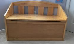 Solid wood toy box; in excellent condition.